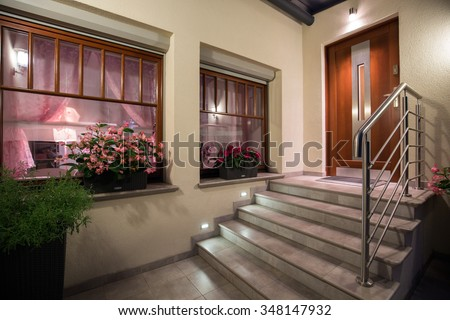 Grey and modern stairs to the house
