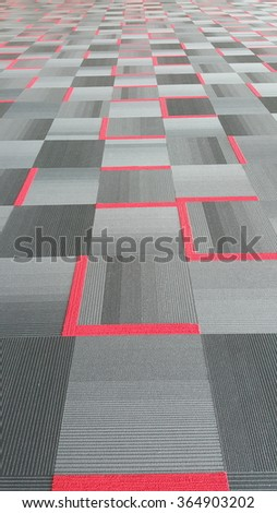 Grey and red modern carpet pattern in perspective view