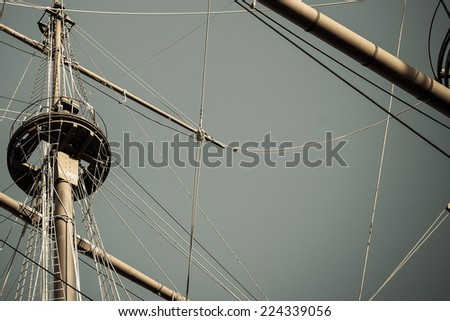grey background with sailing and adventure concept, old ship masts and empty sky