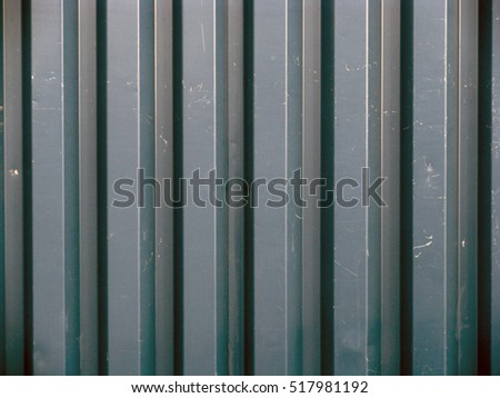 Grey blue color painted corrugated iron sheet close up for background.