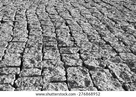 Grey brick stone street road. Light sidewalk, pavement texture - stock photo