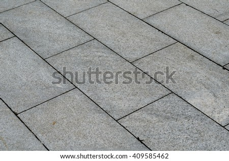 Grey brick stone street road. Light sidewalk, pavement texture - stock photo