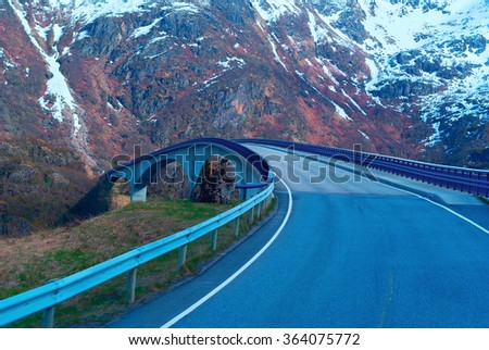 Grey bridge on Norwegian road in the mountains - stock photo
