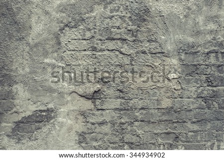 Grey brushed concrete texture with brick wall. Vintage effect.  - stock photo