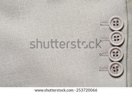 grey button on jacket - stock photo