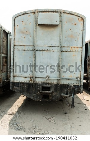 Grey cargo train carriage in train yard, taken on a sunny day - stock photo