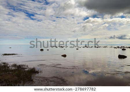 Grey clouds above Baltic sea. - stock photo