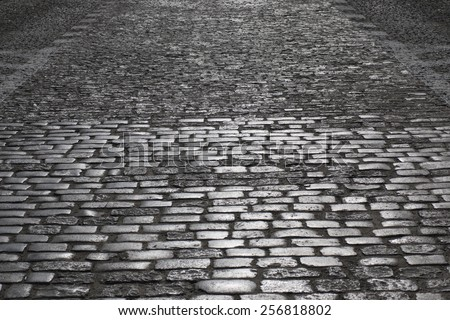 Grey cobblestone road in the night. Warsaw, Old Town. - stock photo