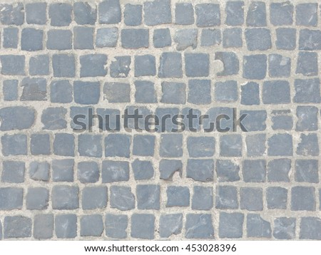 Grey cobblestone sidewalk made of cubic stones - tileable/seamless texture. - stock photo
