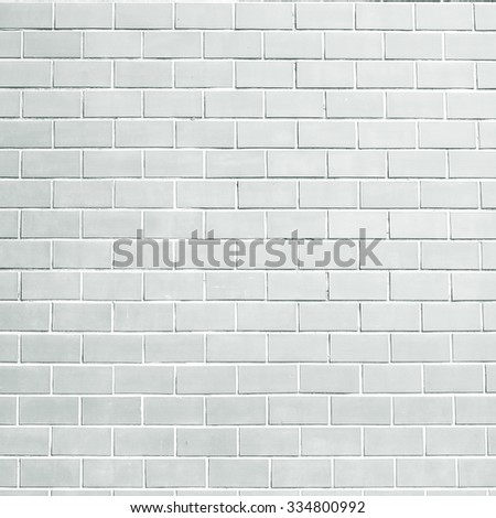 grey color brick stone cement wallpaper background textured:pure brickwork concrete wall background for home interior,design:gray clean stucco backdrop interior.backgrounds concept.display in square - stock photo