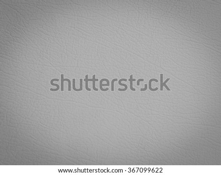 grey color leather background with dark vignette:wrinkle of genuine skin backdrop:crinkle of pure cowskin wallpaper for design,decorate,banner,template:cropped image. - stock photo