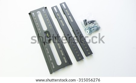 Grey color parts of wall mount brackets for LCD monitor, plasma TV and LED display device. Isolated on white background. Slightly de-focused and close-up shot. Copy space.