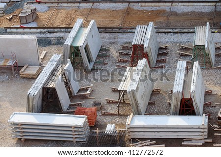 Grey concrete slabs preparing for building under construction, top view - stock photo