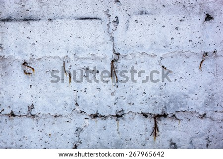 Grey concrete surface with the hardened traces of the shuttering moulds - stock photo