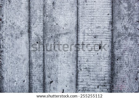 Grey concrete wall with hardened traces of the shuttering moulds. - stock photo