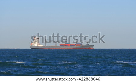 Grey container ships sailing from the port of Antwerpen - stock photo
