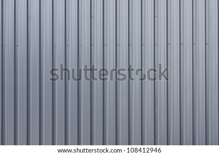 Grey corrugated steel cladding on a industrial building - stock photo