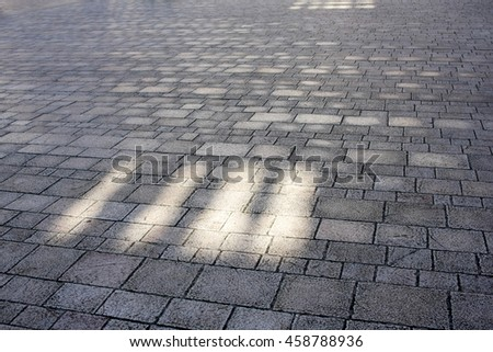 Grey floor made of stone texture background with light from windows - stock photo