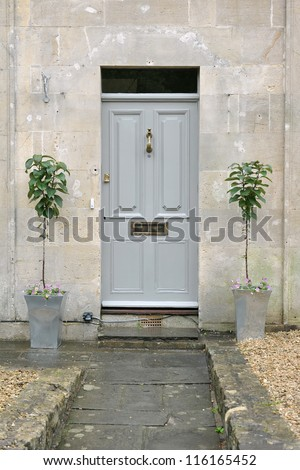 Grey Front Door of an Attractive Georgian Era London Town House - stock photo