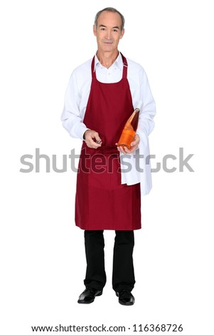 Grey haired waiter holding glass bottle - stock photo
