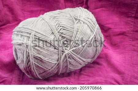grey Knitting roll on fabric pattern background