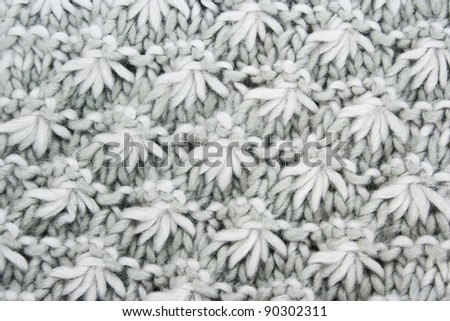 Grey knitwear with ornament  as a background. - stock photo