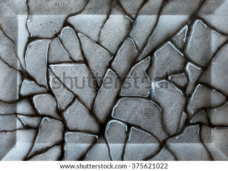 grey marble granite wall with cracks and patches of light painted by airbrush on paper in the background