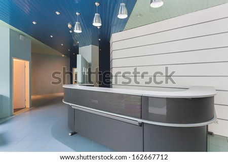 Grey modern reception in an office building - stock photo