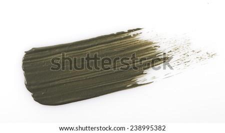 Grey mud scrub cream stroke on white - stock photo