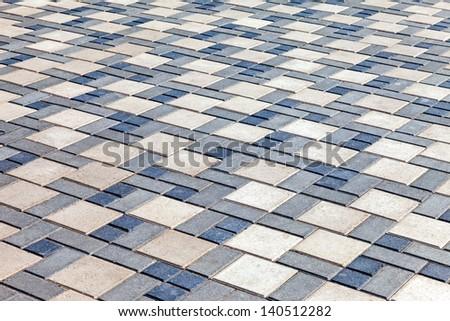 Grey paving stones as background - stock photo