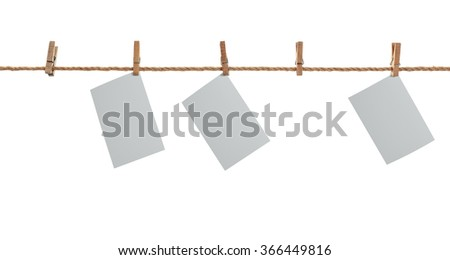 grey photo paper. Hanging on a clothesline with clothespins. On  white background - stock photo