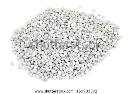 grey plastic polymer granules on white background - stock photo