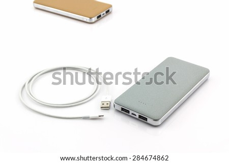 Grey powerbank on white background. - stock photo