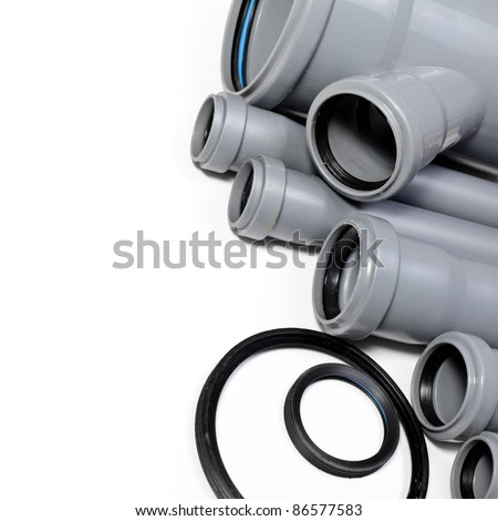 Grey PVC sewer pipes on white background - stock photo