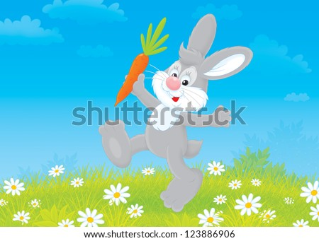 grey rabbit friendly smiling and jumping with a carrot - stock photo