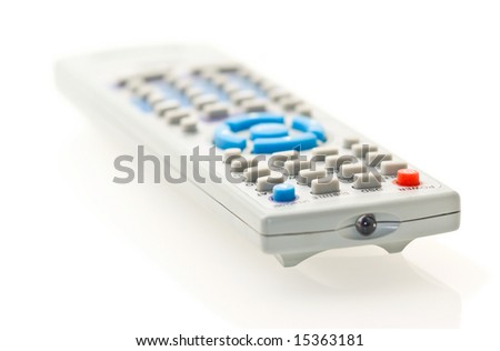 grey remote control for TV over white. Shallow DOF. - stock photo
