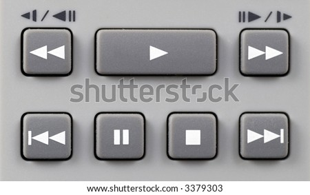 Grey remote control playback keypad with white symbols - stock photo