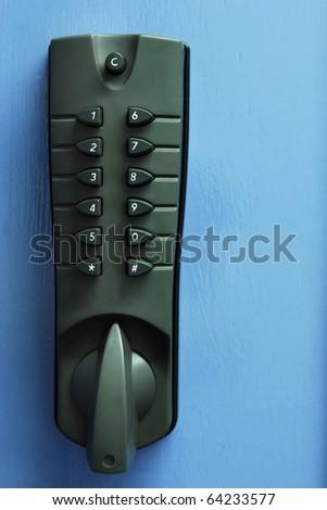 Grey security numbered door lock against blue door - stock photo