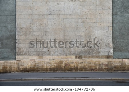 Grey stone wall with vertical bars - stock photo
