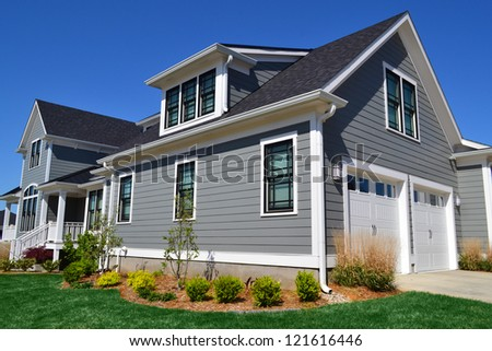 Grey Suburban American Cape Cod Home - stock photo