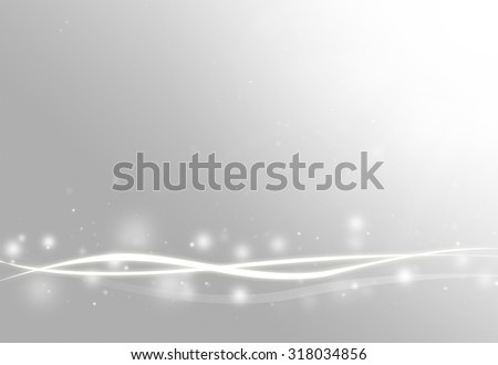 Grey wave and glitter sparkle defocused rays lights bokeh abstract background. - stock photo