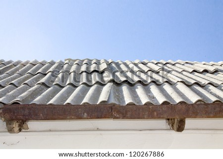 Grey waved asbestos roof - stock photo