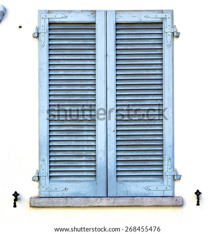 grey window  viladosia  palaces italy   abstract  sunny day    wood venetian blind in the concrete  brick    - stock photo