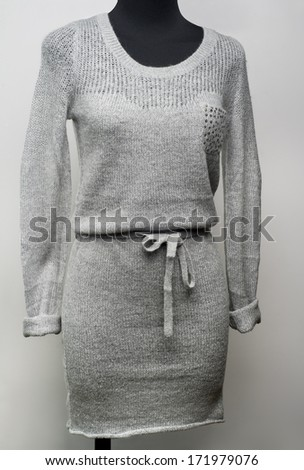 Grey wintry dress on a mannequin - stock photo