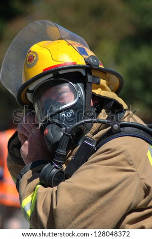 GREYMOUTH, NEW ZEALAND, FEBRUARY 6, 2007 - Fireman adjusts his breathing apparatus at a training session, February 6, 2007