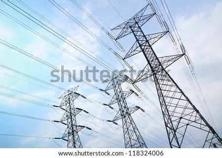 Grid electricity transmission towers - stock photo