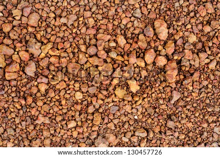 grid gravel background with different shapes of rocks - stock photo