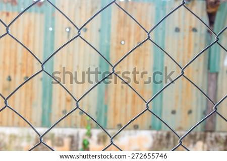 Grid, Metal mesh fence, Corrugated zinc - stock photo