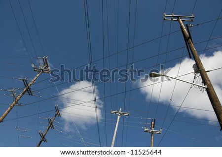 grid of power lines on pole