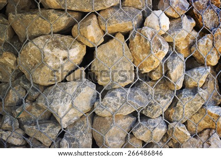 Grid with small gray granite stones, background - stock photo